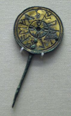 The Malton pin. Anglo-Saxon copper alloy gilded disc-headed pin inscribed with eleven runic letters.