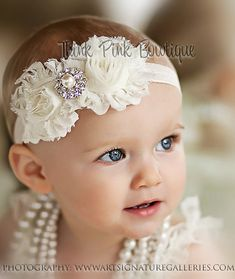 NEW FB FANS RECEIVE A 10% DISCOUNT! Just add my FB page and convo me on ETSY to get your 10% off code!  http://www.facebook.com/ThinkPinkBows  Headband as pictured in Ivory. This beautiful headband features two frayed shabby chic flowers on an elastic headband. It is topped with a luxurious and eye catching rhinestone. The flowers are felt backed for comfort. Simple and yet elegant, sure to be a real head turner!! Pair it with one of our adorable lace petti rompers for a complete look. Size…