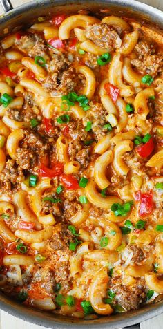 One-Skillet Mac and Cheese with Sausage and Bell Peppers, smothered in marinara sauce and cream.