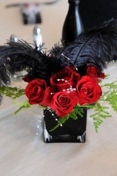 center pieces... Love this! Our theme is old hollywood glam n our colors are white n black with some red.