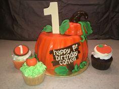 Pumpkin first birthday smash cake with pumpkin birthday cupcakes by yuMM