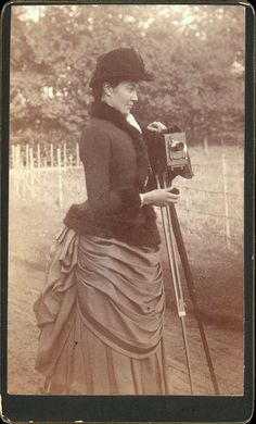 ca. 1890's, [cabinet card, portrait of a woman with a camera] sooo glad we don't have to wear all this any more