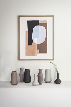 Collection of contemporary looking pottery, maybe addition of a flower for color.