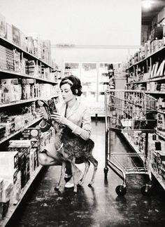 Audrey Hepburn shopping with her pet deer in Beverly Hills, CA, 1958