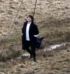 Dramatic pictures show Harry Styles dangling in mid-air during new music video shoot... as we reveal secrets of debut single