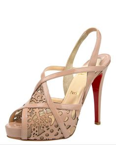 Dare to be feminine in this lace-like leather Christian Louboutin sandal.