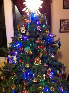 Putting your Christmas village in the tree is a great surprise and looks really great.