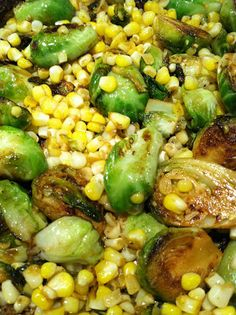 great summer side dish: pan seared brussel sprouts & corn with lemon, cayenne pepper, garlic, onion, salt & pepper.