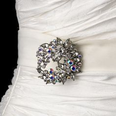 "This beautiful brooch is shown on a long bridal belt, wedding sash which may be tied into a bow in the back of your dress or you may have a seamstress shorten and sew the belt directly to your gown for those who do not want a ""bow tied look"" in the back of the gown but still desire a belt effect. Bridal belt sash is 95"" long for versatility. #timelesstreasure"