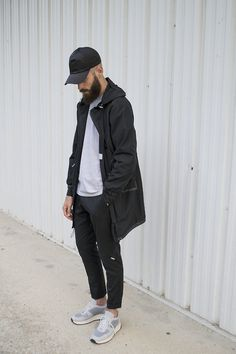 Acne studios cap Sandro jacket Ami Paris trousers Common projects track shoes.