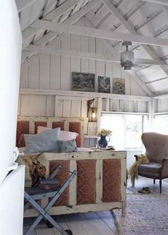bed made from doors and beautiful exposed beams.