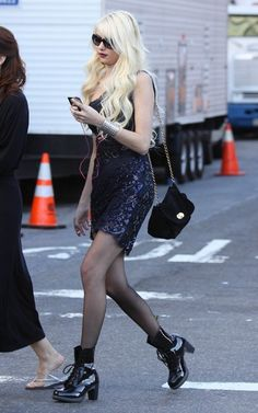 "Taylor Momsen in glam dress with black ""Darcie"" Doc Martens from the Diva line."