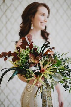 autumn winter bouquet - photo by Our Labor of Love by Heidi http://ruffledblog.com/gilded-winter-romance/