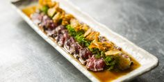 A delicious beef fillet recipe inspired by the Japanese tataki preparation, where meat is seared and quickly cooled to halt the cooking process. Served with ponzu sauce, this is a beautiful Japanese starter recipe.