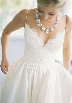 love this neckline, only with a lace overlay with higher neck/sleeves  The dress from 27 dresses!