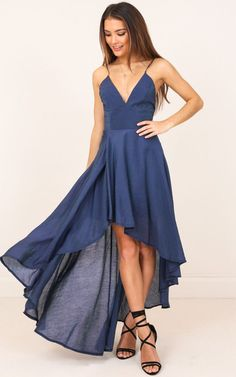 This dress will totally make you smile in the mirror when you see yourself looking stylish as hell! The stunning combination of its high-low cut, backless design and navy shade will turn heads at your next occasion!