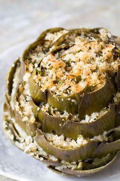 Stuffed artichokes are a perfect artichoke appetizer! Globe artichokes are trimmed and stuffed with herbed parmesan breadcrumb stuffing, then… Lunch Snacks, Clean Eating Snacks, Healthy Snacks, Healthy Recipes, Baked Artichoke, Stuffed Artichoke Recipes, Best Artichoke Recipe, Tartiflette Recipe, Italian Appetizers