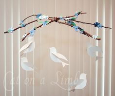 I didn't make this mobile, but I did use the templates to make some colorful birds for my daughter's nursery walls.  Using the 3M double-sided poster hangers, the birds can be stuck to the wall.