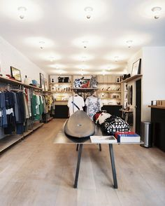 Surfboards and apparel on display in a retail environment.  Saturdays NYC