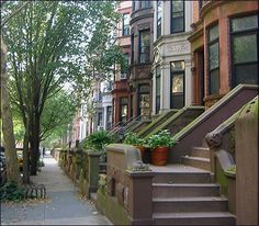 The brownstones of New York.  Gosh, I wish I had the money to buy one!  Such beautiful buildings.
