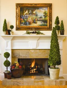 Preserved Boxwood is the classic and elegant  way to add style to any home. #preservedboxwood #boxwood #topiary #homedecor #fireplace #classic #elegant #style