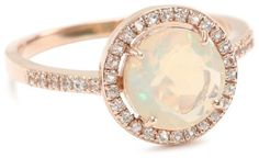 Round cut opal set in rose gold.