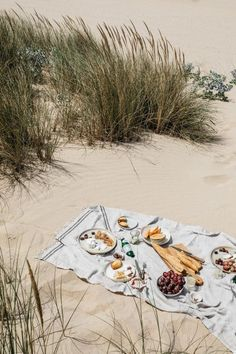 Let's hit the sand and have a fabulous beach picnic! Pack a Picnic Basket with some yummy bites and a bottle of Wine, and grab a Blanket. It's on my beach bucket list!