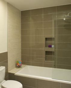 """The tub face has 12""""x24"""" tile with a linear fabric-like design, in a khaki and cream color blend. Interesting."""