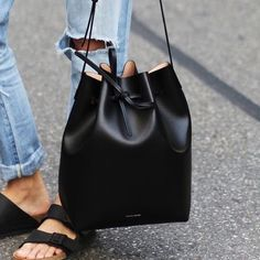 """NEW Mansur Gavriel Mini Black Ballerina Bucket Bag New! Mansur Gavriel Mini Black + Ballerina Interior Leather Bucket Bag. Made in Italy. Vegetable Tanned Leather Construction. Detachable Wallet. Adjustable Strap. Measurements: 10"""" H x 7.5"""" W x 5"""" D. Finally UPGRADED to a Mini & was Gifted this Brand New One  Similar Minimal Style to Brands as La Garçonne, Totokaleo, Acne, Reformation, Saint Laurent, Marni, Prada, Channel, Givenchy, Michael Kors, Kate Spade, Need Supply, Brandy Melville…"""