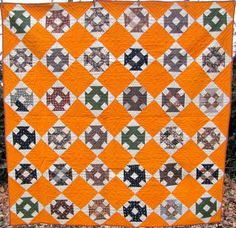 A Churn Dash quilt with blocks of late 19th century fabrics set against a background of cheddar. Found in Lancaster Co., PA, measures about 70 inches square and dates ca 1890.