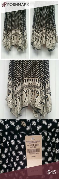 ♡American Eagle paisley asymmetrical skirt black♡ American Eagle paisley asymmetrical boho printed midi skirt in black, ivory, and gold! It's super soft viscose, has an adorable pattern, and is a size medium! =) Perfect for Fall layering! Adorable with a sweater and boots! New with tags ♡ $45.00 American Eagle Outfitters Skirts Asymmetrical