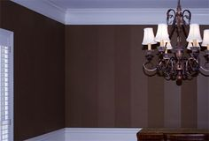 One color: gloss and matte striped walls with white baseboards/crownmolding... LOVE this!