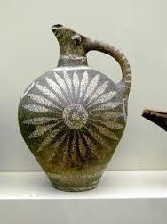 Bronze Age pottery with a flower design made by the minoans.