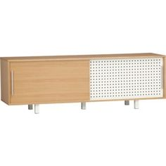 """CB2 grid media console. 66""""Wx18""""Dx22""""H  Low-emission engineered wood with white oak veneer case and door  White hi-gloss powdercoated steel legs and door with perforated grid  Aluminum handles  Two adjustable shelves  Finished back with cord management channel  $499"""