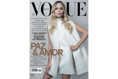 Russian Bombshell Blonde Natasha Poly stands suave for Vogue Brazil (February 2015)