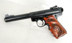 """Ruger Mark III Target Pistol .22 LR 5.5"""" *NIB*. Model 10159. Ruger Mark III pistols continue the legacy created by the Ruger Standard, Mark I and Mark II pistols, plus incorporate many new engineering refinements. This Target model is made from alloy steel, and features a blued frame and bull barrel, and Ruger Target laminate wood grips. Adjustable rear sight, fixed front sight. 10-round capacity of .22 LR. 5.50"""" barrel. 43.2 oz. $399.99"""