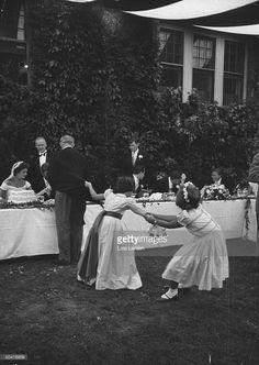 Two little girls playing at John F. Kennedy's (L) wedding breakfast.