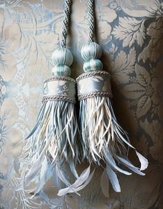 RUSSIAN SILK TIEBACK Beautifully crafted with the finest silk work, exquisite braiding and stripped goose and coque feather fringe