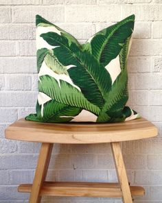THE print of the season!  A stunning tropical palm leaf print in luscious tones of green on creamy white. -100% polyester indoor/outdoor fabric -Invisible
