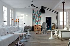Paola Navone made her Parisian apartment feel like an eclectic summer country house. The space is open, white with wooden floors and brick walls, full of color and mood. This apartment is really great, playful as well as warm and harmonious. Living Room Designs, Living Room Decor, Living Spaces, Paola Navone, Turbulence Deco, Design Apartment, Apartment Interior, House Design Photos, Eclectic Style