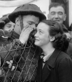 A British solder whispers to his sweetheart before leaving for the front, 1939.