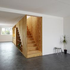 Eclépens apartment interiors with boxy wooden furniture by Big-Game | A combined staircase...