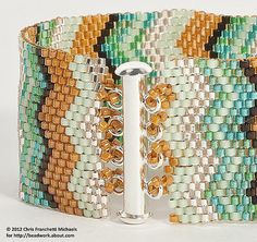 Learn how to attach a slide lock tube clasp to a peyote stitch cuff bracelet using beaded loops with our step by step tutorial.