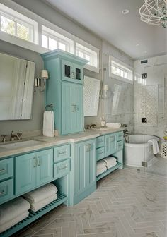 """Cabinet Paint Color: """"Sherwin Williams SW 9051 Aquaverde."""" Wall color is """"Sherwin Williams Silver Strand"""".   Southern Living Showcase Home - 2017"""