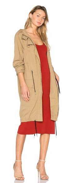 Carine Coat by A.L.C.. Anorak meets design, A.L.C.'s Carine Coat covers all bases. Rendered with an attached hood, cargo pockets, and a util...