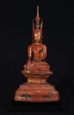Antique bronze Shan Buddha Material: Bronze 43 cm high The Buddha is 40 cm high The wooden base is 21 x 12,5 cm Shan (Tai Yai) style Bhumisparsha Mudra 17-18th century Gilded with 24 krt gold A large Buddha in high quality, therefore very rare and special ! Originating from Burma