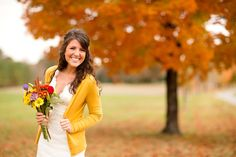 Yellow cardigan and a wedding dress. Love it.
