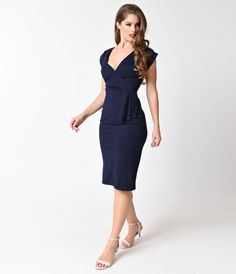 Let the evening begin, dames! A stunning vintage dress in a dark navy blue in proper Banned fashion. This fitted wiggle dress is complemented by pleated details at the plunging V-Neck bodice and waist, with subtle cap sleeves. Crafted in a lusciously soft