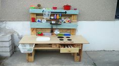 Mud kitchen for toddler. Montessori practical life.