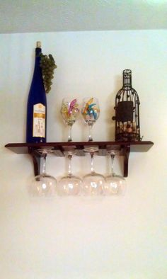 Decorative wine glass rack: bought the shelf at Menard's and added L shaped trim to hold the wine glasses, then stained it to match my furniture.